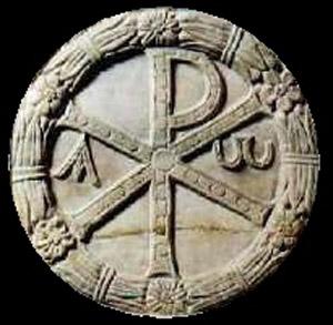 """Il """"Chi-rò"""", simbolo del paleocristianesimo, riconducibile al simbolismo della ruota forata di Fetonte. Dopo l'avvento storico di Costantino venne da questi sostituito con la croce, relegandolo alle opere dei morti"""