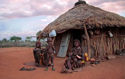 A Hamar family sit outside their home, Omo Valley, Ethiopia. The Gibe III dam that is being constructed will destroy their people's livelihood (Image: Magda Rakita/Survival)